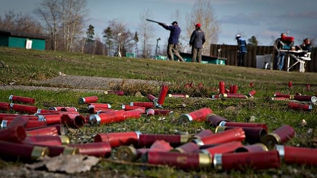 The ground is littered with spent shotgun shells at the Vancouver Gun Club in Richmond, B.C. in February. Gun licence holders will soon receive a mass mailout as the federal government prepares to collect an estimated $18 million in previously-waived firearms fees.