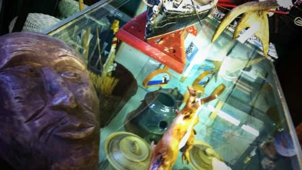 At last count, the Newfoundland Emporium had 16,555 items for sale in the museum-like, three-story Corner Brook shoppe. A few of the items are found within and on top of this backroom glass case.