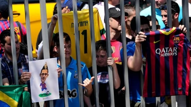 FC Barcelona fans wait outside the gates at Camp Nou for the arrival of Neymar on Monday.