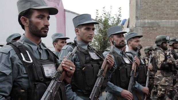 Afghan soldiers stand at attention during the third phase of a transfer of authority ceremony from the NATO-led troops to Afghan security forces in Kunar province, east of Kabul, Afghanistan.