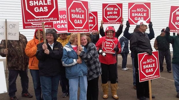 A group of protesters gathered outside a campaign rally for Jimmy Bourque.