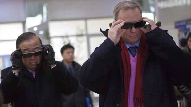 Executive Chairman of Google, Eric Schmidt, right, tries on 3-D glasses as he looks at North Korean-developed computer technology during a tour of the Korean Computer Center in Pyongyang, North Korea on Wednesday, Jan. 9, 2013. At left is Kun Tony Namkung, a North Korean expert and member of the travelling delegation.
