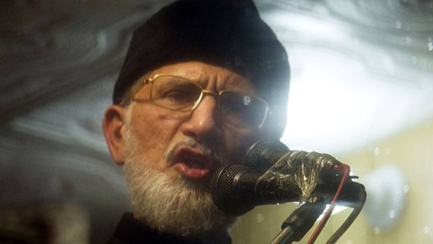 Pakistani cleric Tahir-ul-Qadri, who spent years in Canada, addresses a rally from his bullet-proof container in Islamabad, Pakistan, on Thursday. Qadri has struck a deal with Pakistan to end days of protests calling for the government's dissolution.
