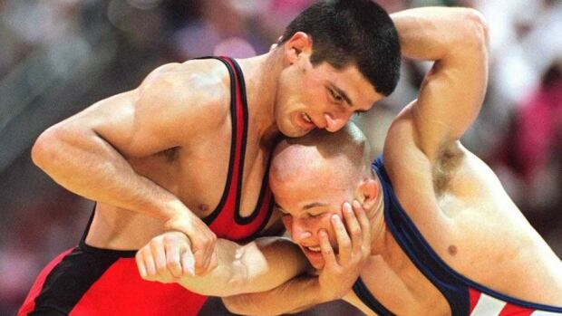 Armen Nazaryan, left, shown here competing in the 1996 Olympics in Atlanta, started a hunger strike to protest the IOC's decision to eliminate wrestling from the Games in 2020.
