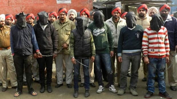 Indian police officials present six arrested men, accused of a gang rape in Punjab state, for an appearance at court in Gurdaspur on Sunday.