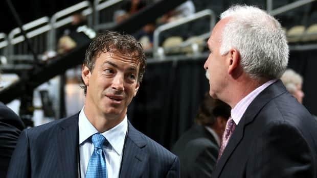 Joe Sakic, seen talking to John Davidson at the 2012 NHL Draft, retired as a player in 2009.