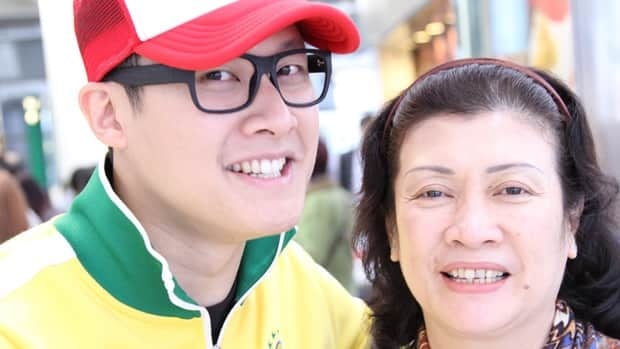 Joe Yau picked his mother up at Hong Kong's airport on Friday after she arrived from Indonesia. They were one of many families reuniting for Lunar New Year.