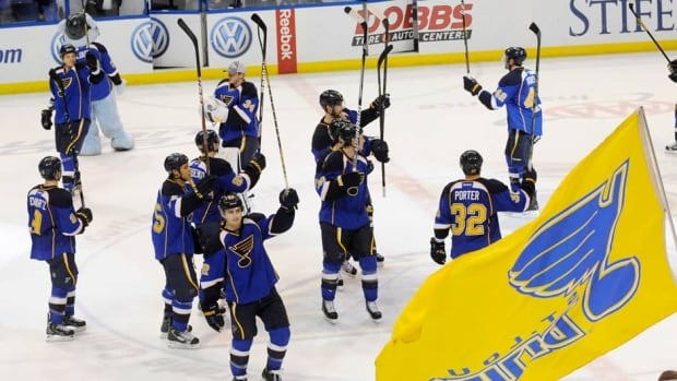 St. Louis Blues players acknowledged their fans after defeating the Colorado Avalanche Tuesday night. The victory clinched a playoff spot for the Blues.