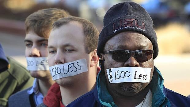 Protesters hold a silent protest in Lansing, Mich., Wednesday, Dec. 12, 2012, a day after right to work legislation was enacted in the state. Officials in Hamilton say they worry those laws could start affecting Hamilton in the future.