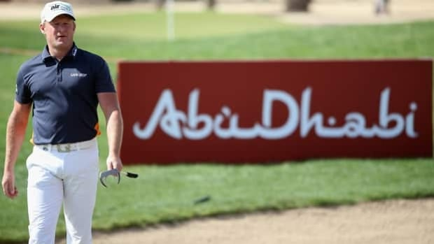 Jamie Donaldson sizes up a shot from the lip of a bunker at Abu Dhabi Golf Club on Thursday.