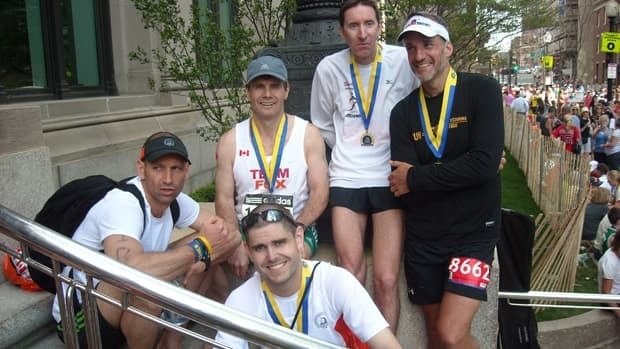 Sean Squires, top row second from left, and members of the Beaches Running Club after completing the 2012 Boston Marathon. Squires, who has already qualified for next year's race, says he is very likely to attend despite Monday's bombing at the finish line.