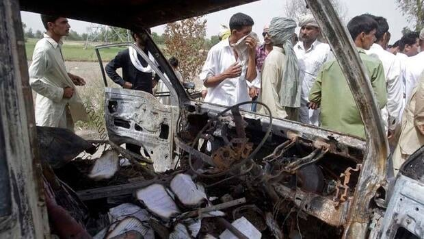The minibus burst into flames after a gas cylinder explosion in Gujrat.
