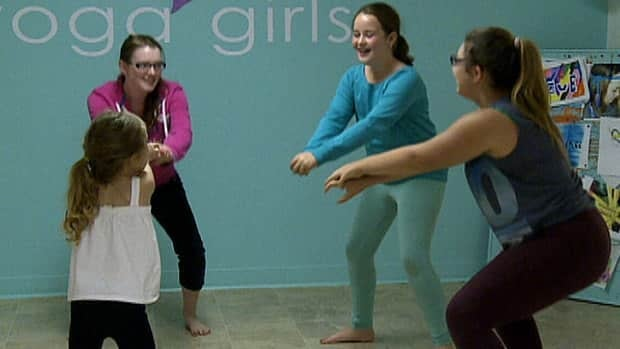 4-H member Ann Younker leads a group of young girls in a yoga class as part of a 4-H project, work she will not be able to apply towards a high school credit.