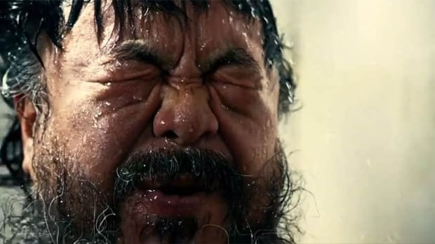 Prison guards watch Ai Weiwei as he eats, sleeps, paces, showers  and even sits on the toilet in Dumbass, the Chinese artist's new obscenity-filled, metaphor-rich music video mocking state power, released Wednesday but blocked online in mainland China.