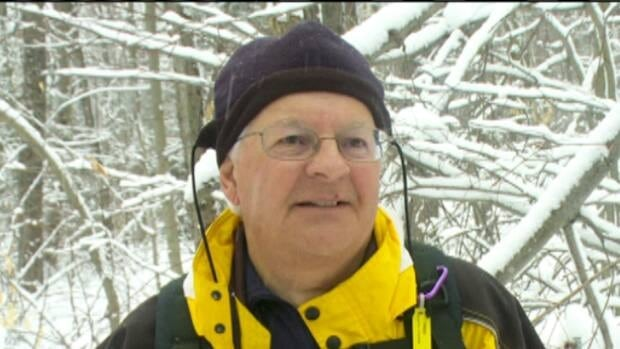 Gilles Simard says he lost 10 pounds in a month helping to clear trails of branches and overhanging trees in Gatineau Park.
