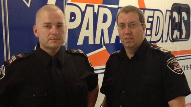 Paramedics Kelly Straf (left) and Sheldon Hirschfeld were first on the scene of an apartment building on fire.