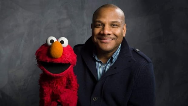 """Kevin Clash, shown here holding the puppet Elmo, resigned from """"Sesame Street"""" in November after college student Cecil Singleton sued him for more than $5 million, accusing Clash of having sex with him when he was 15."""