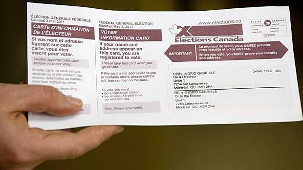 A woman displays her voting card prior to casting her ballot in Canada's federal election in Montreal May 2, 2011. Liberal MP Bob Rae's resignation means a byelection will be called in the riding of Toronto Centre.