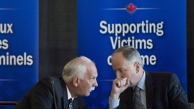 Vic Toews, who was then public safety minister, and Justice Minister Rob Nicholson (right) are shown at the launch of consultations on the victims bill of rights on April 23, 2013. The government has extended the consultation period by two months, but the proposed legislation is already generating controversy - even among victims advocates.