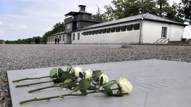 White roses lie on a memorial plaque in front of the former Buchenwald Nazi concentration camp, one of three camps where Leopold Engleitner was imprisoned during the Holocaust.