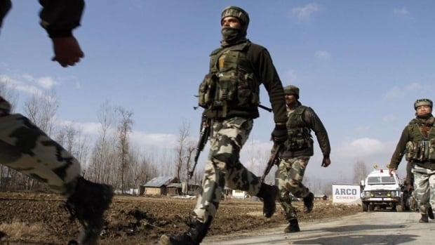 Indian army soldiers run during a gun battle in Dec. 2012 in the Indian portion of Kashmir. India said Tuesday that Pakistani soldiers killed two of its troops Tuesday.