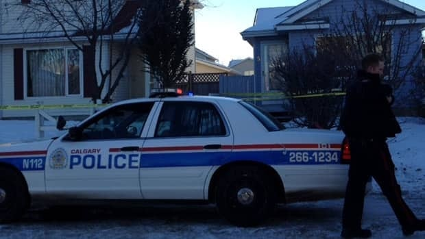 Police surrounded a house in northeast Calgary after a fatal stabbing early Saturday morning.