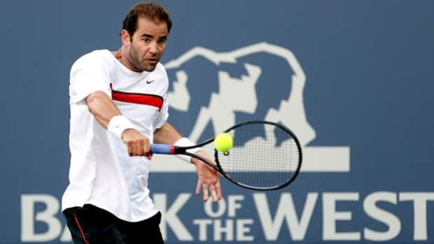 Pete Sampras, seen playing an exhibition match last July 11, won 14 Grand slam titles.