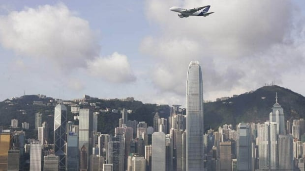 An Airbus A380 flies over Victoria Harbour in Hong Kong. Canada's first tax treaty with the territory stands to make it harder for investors and other businesspeople to pay too much or too little tax.