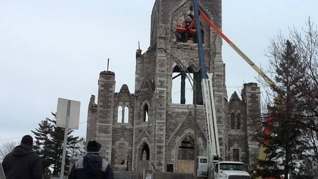 Workers began the demolition process at St. Paul's Catholic Church in Aylmer, Que., Wednesday as parishioners watched.