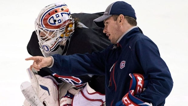 Canadiens goalie Peter Budaj, seen here receiving instructions from goaltender coach Pierre Groulx, struggled in the playoffs along with Carey Price. The team announced on Monday it would not renew Groulx's contract.
