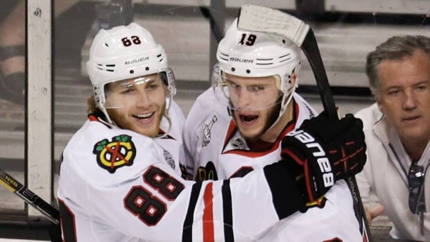Chicago Blackhawks centre Jonathan Toews (19) celebrates his goal with Blackhawks right wing Patrick Kane (88) during the second period in Game 4 of Stanley Cup final against the Boston Bruins on Wednesday.
