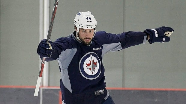 Winnipeg Jets Zach Bogosian takes part in an informal hockey practice in Winnipeg on Monday. The practice did not include any locked out players because a new labour deal has yet to be ratified.