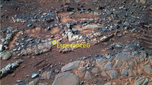 This image from the panoramic camera on NASA's Mars Exploration Rover Opportunity shows a pale rock called Esperance, which was inspected by the rover in May 2013.