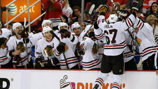 Michael Frolik (67) of the Chicago Blackhawks celebrates his third period penalty shot goal with his teammates in Game 6 against the Detroit Red Wings.