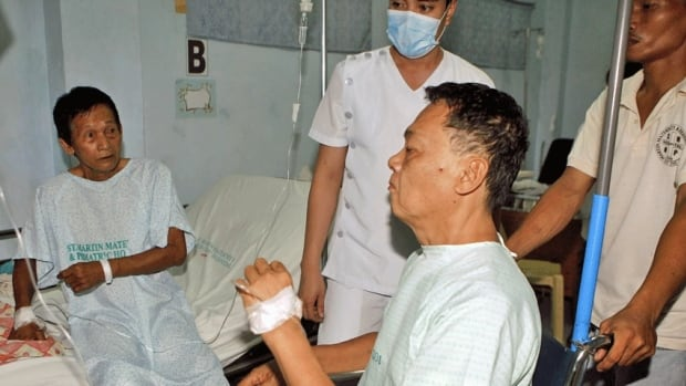 Injured victims of a shooting rampage in the Philippines are assisted inside a hospital in the Cavite province, south of Manila on Friday. At least eight people were killed and at least eight injured after a man, suspected to be under the influence of illegal drugs, began to open fire, accoridng to local media.