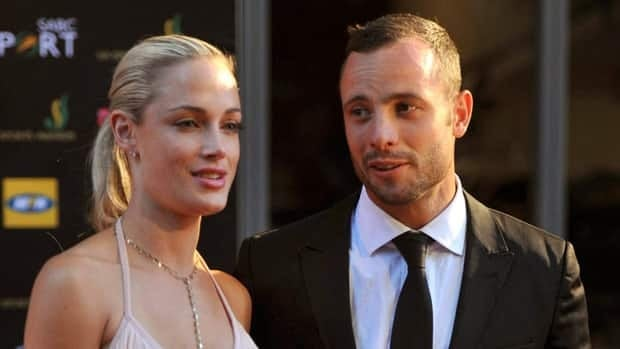 Oscar Pistorius and Reeva Steenkamp are seen at an awards ceremony in November, just three months before she was shot to death and he was charged with her murder.