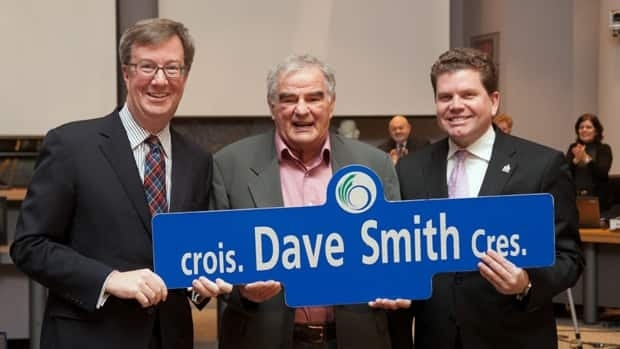 Mayor Jim Watson and Gloucester South Nepean Councillor Steve Desroches with well-known Ottawan Dave Smith (centre) who'll soon have his very own street in Riverside South.