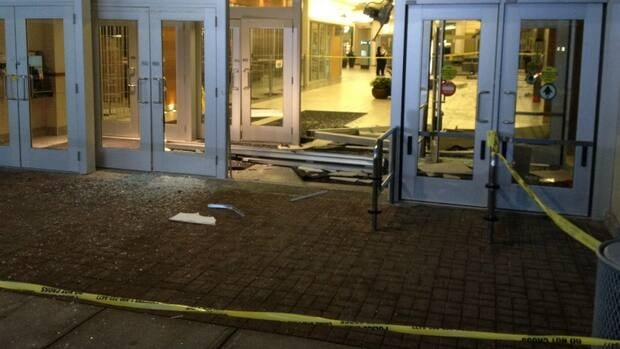 Calgary police say two suspects in a white Dodge SUV rammed their way into Market Mall, stealing $139,000 in high-end watches.
