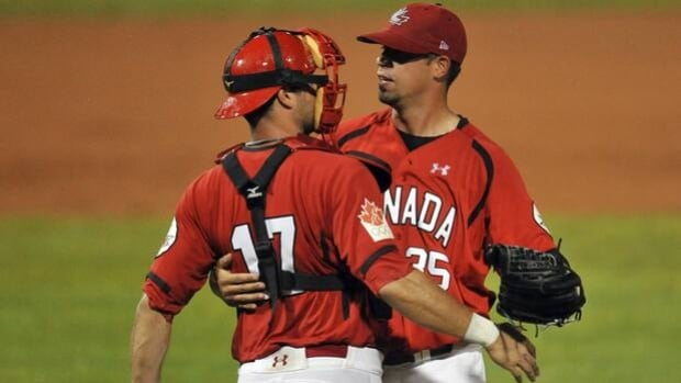 Team Canada pitcher Dustin Molleken, right, plays pro ball for Japan's Nippon Ham Fighters.