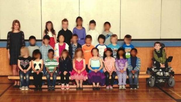 Seven-year-old Miles Ambridge, far right, in his Grade 2 class photo.