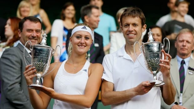 Wimbledon mixed doubles champions Kristina Mladenovic of France, left, and Daniel Nestor of Canada also advanced to the French Open final last month.