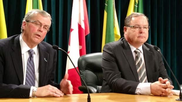 Robert Watson, left, the president of SaskPower, and Bill Boyd, the minister responsible for the Crown corporation, discuss the utility's annual report and plans.