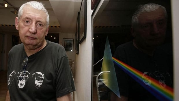 Storm Thorgerson is seen next to his artwork for Pink Floyd's The Dark Side of the Moon album during the opening of his 2008 exhibition Mind Over Matter: The Images of Pink Floyd in London. The British graphic designer has died at the age of 69.