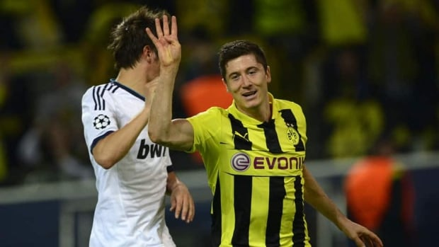 Polish striker Robert Lewandowski of Dortmund holds up four finger after scoring this fourth goal against Real Madrid Wednesday in Germany during the opening leg of the Champions League semifinals.