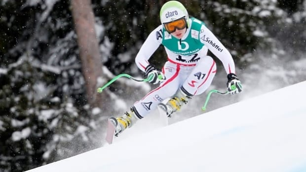 Defending super-combined champion Anna Fenninger skis the downhill in Schladming, Austria.