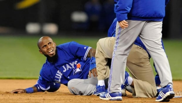 Toronto Blue Jays' Jose Reyes looks at his manager John Gibbons as he reacts to the pain after hurting his ankle against the Kansas City Royals on Friday night.