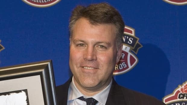 Ron Lancaster Jr. an award on behalf of his late father in Montreal on Nov. 20 2008.