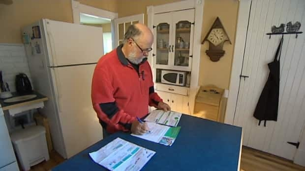 Earl Acker was among 90,000 Nova Scotians to receive the home energy report comparing their power usage to similar households. He says he never gave consent for his personal information to be used.