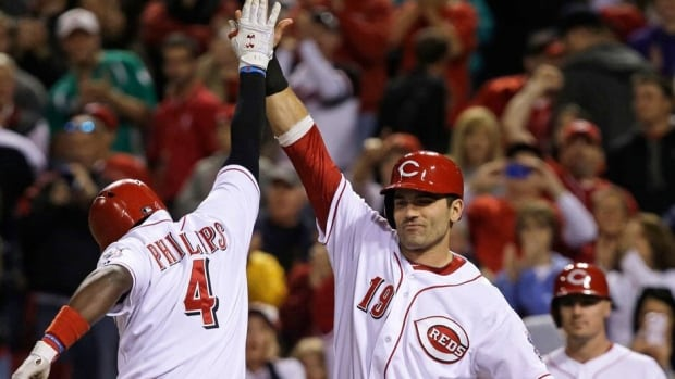 Canadian Cincinnati Reds slugger Joey Votto, right, is hitting .358 this season for his club.