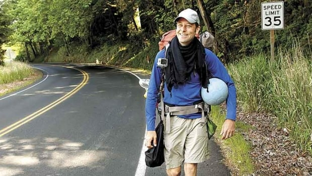 Richard Swanson, of Seattle, walks along a road in Kelso, Wash. Swanson, who was trying to dribble a soccer ball to Brazil in time for the 2014 World Cup, died Tuesday, after being hit by a pickup truck on the Oregon Coast.